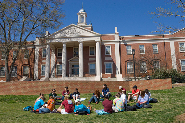 Students study on the lawn in front of Park Hall