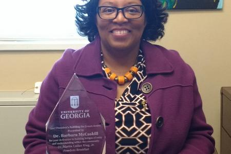 Dr McCaskill with the award